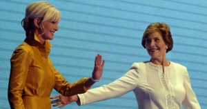 Laura Bush guides the Cindy McCain 3000 robot to the podium