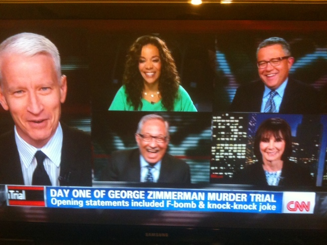 Anderson Cooper and panel share a laugh while discussing a murder trial.
